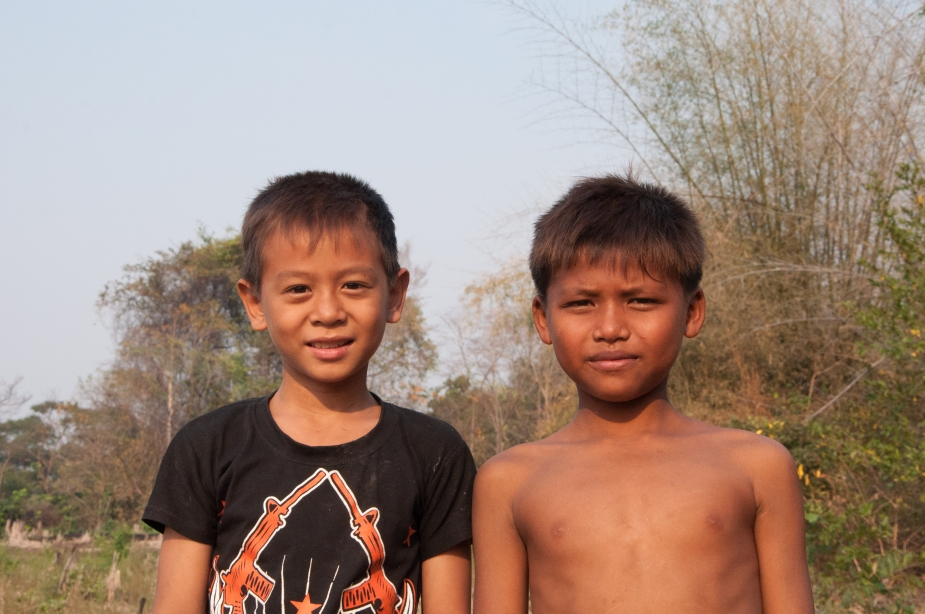 Two boys in Koh Dambong village pose for a photo